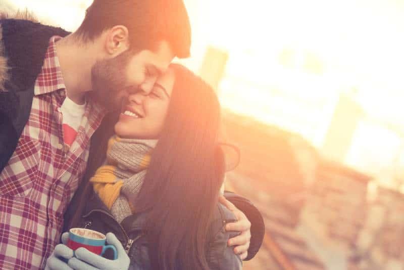 lovely couple hugging outside