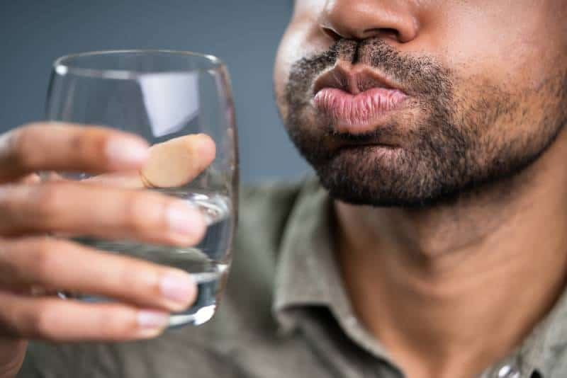 man fill mouth with water