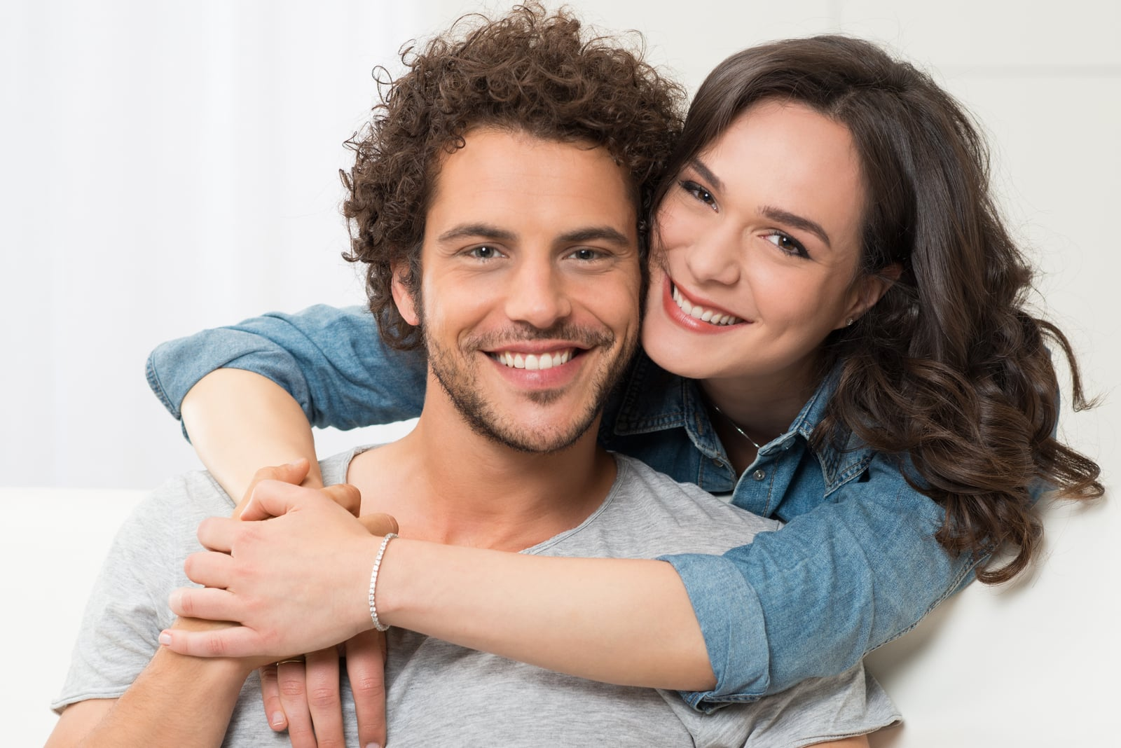 portrait of young smiling man and woman