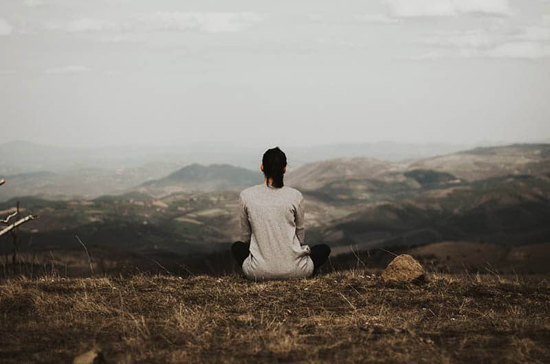 sad lonely woman sitting in nature