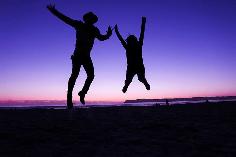 silhouette of persons jumping