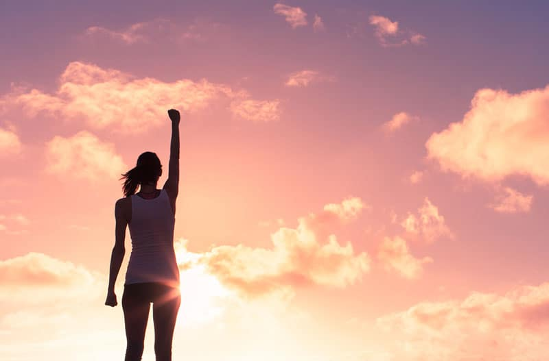 strong woman raising hand in the air