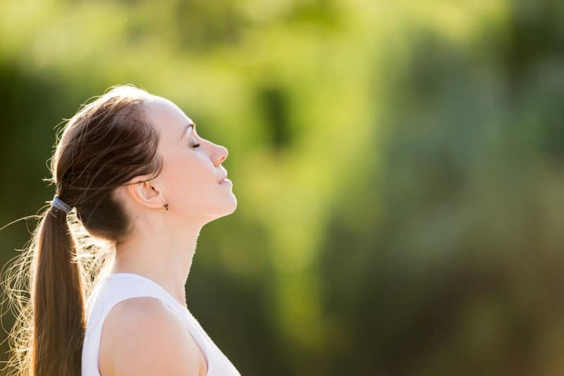 woman breathing fresh air outdoor