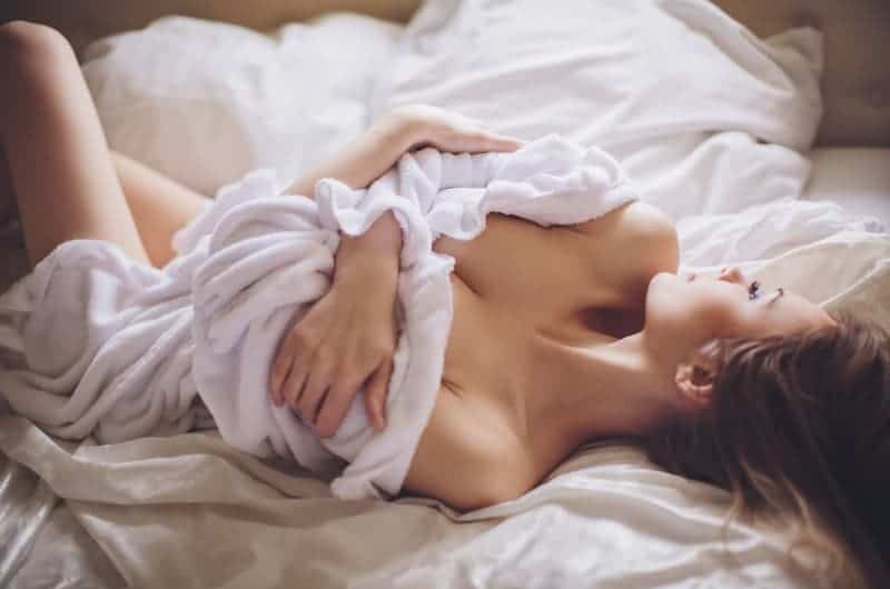 woman in towel on bed