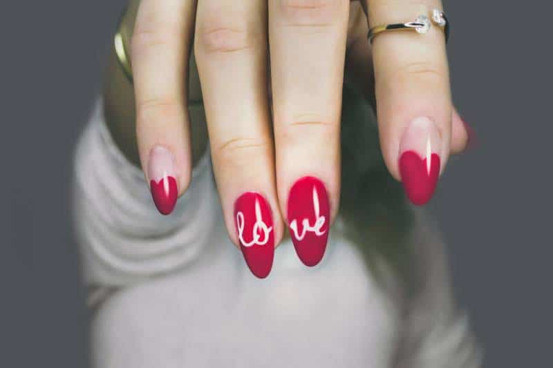 woman's pink manicure
