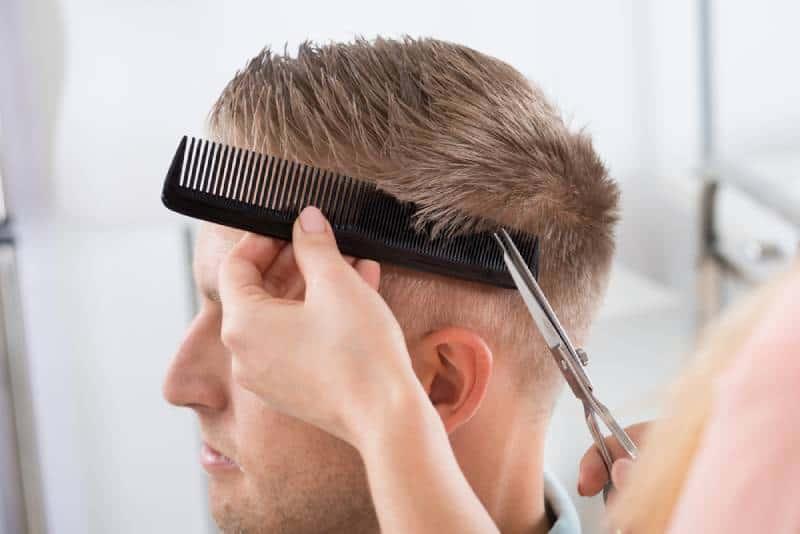 young man getting haircut