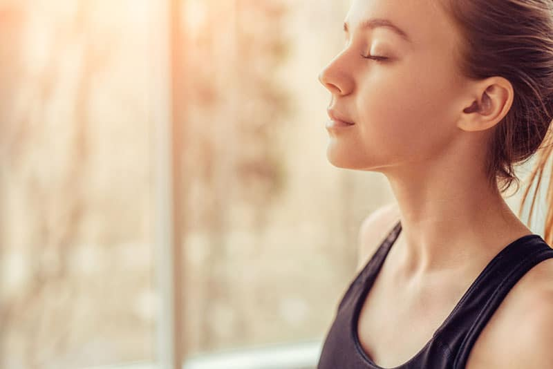 young woman breathing