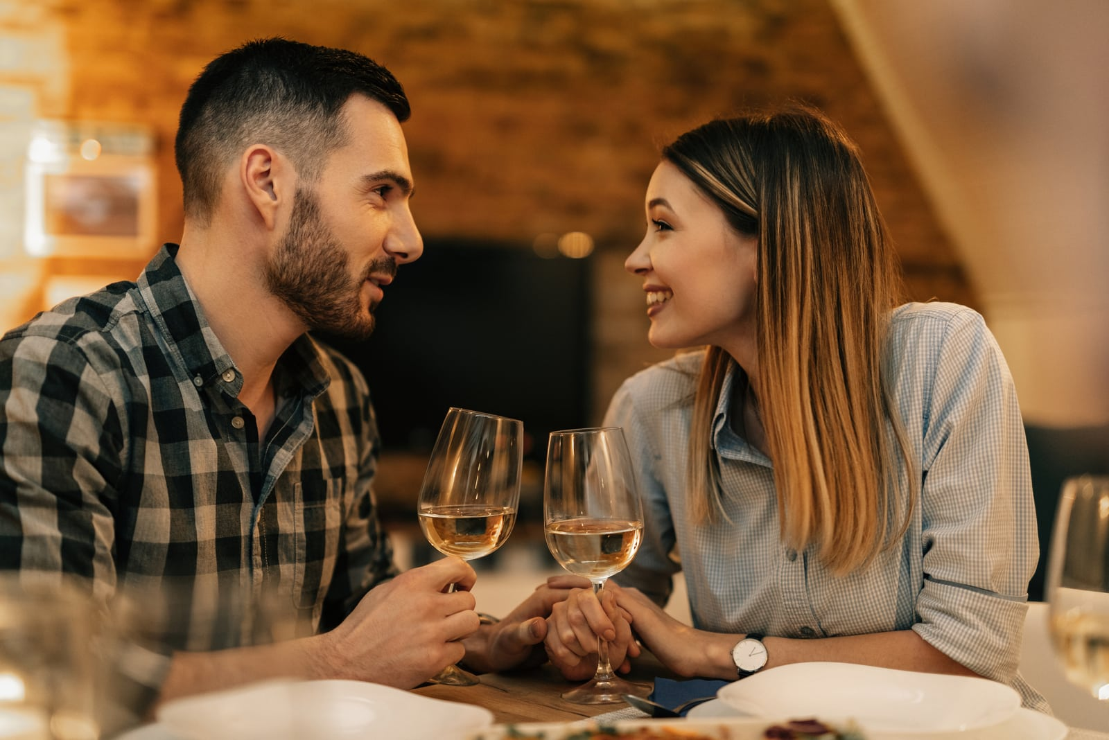 charming couple talking at dinner