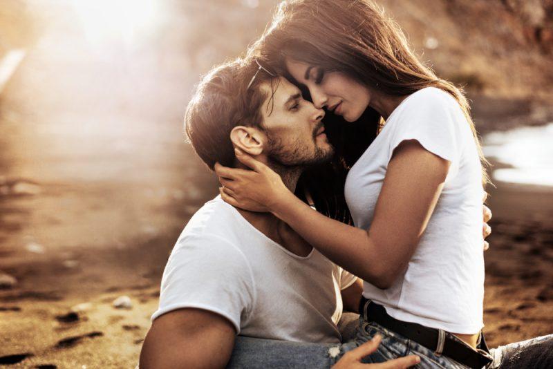 handsome man hugging woman