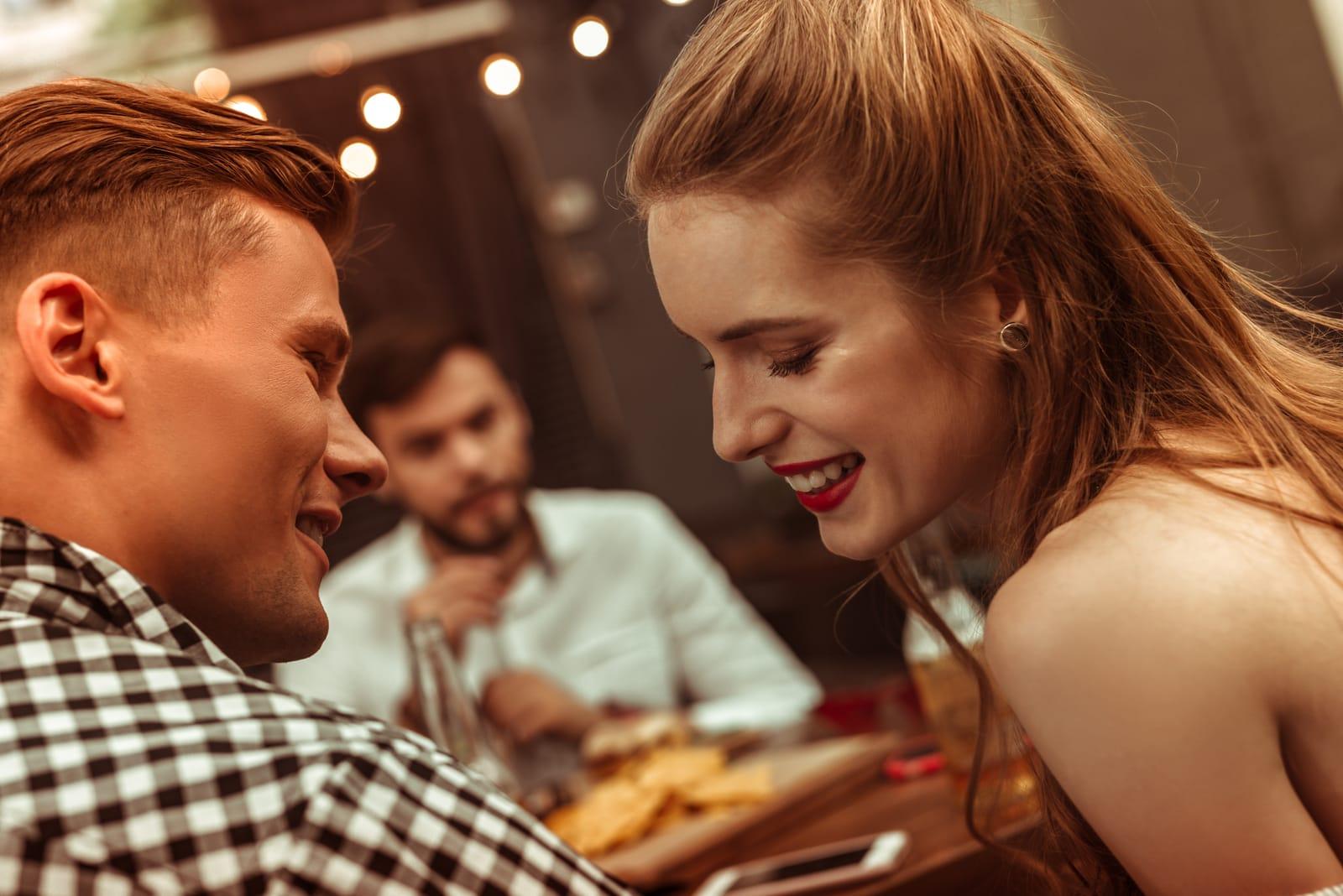 man flirting with shy woman