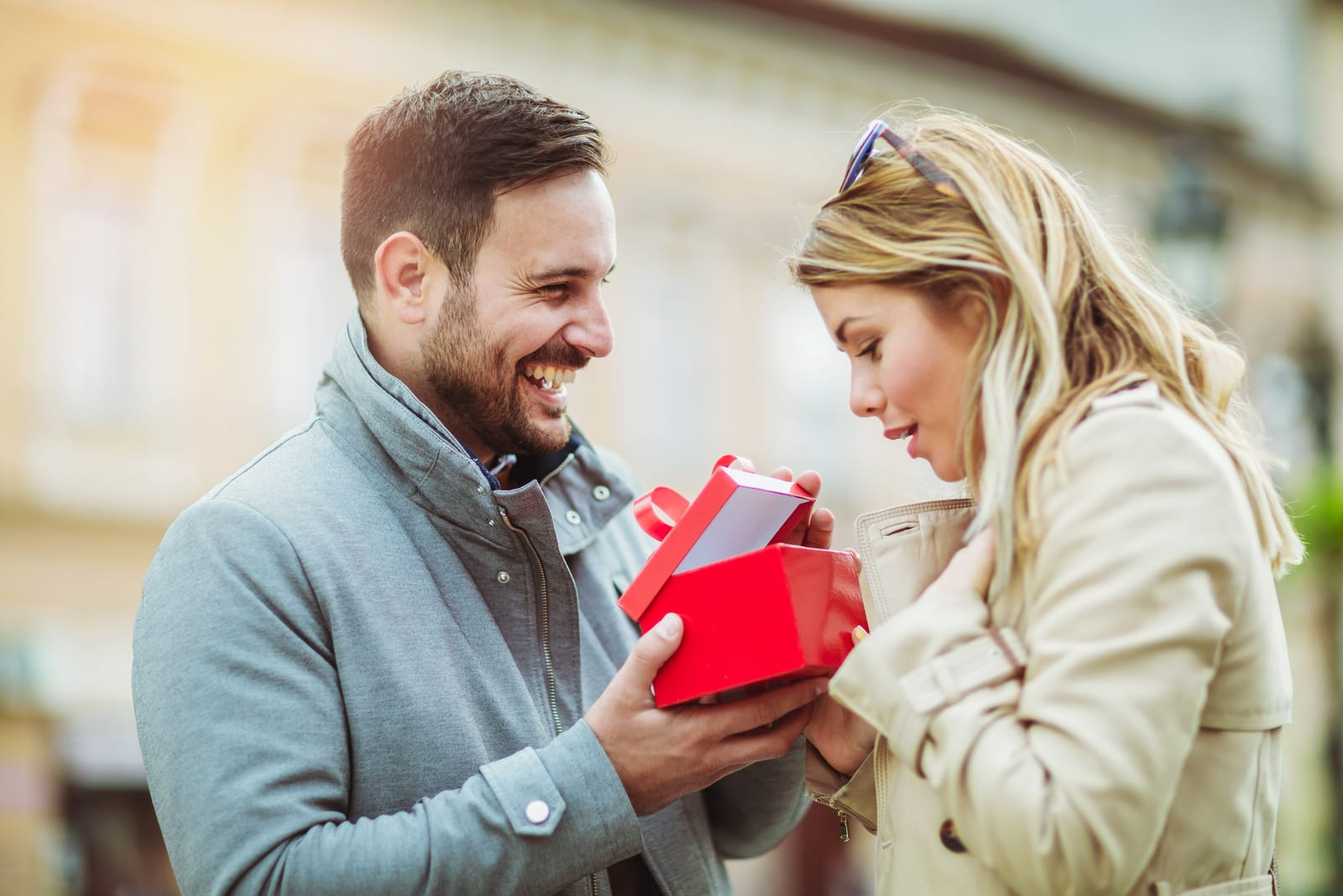 man giving a gift to the woman