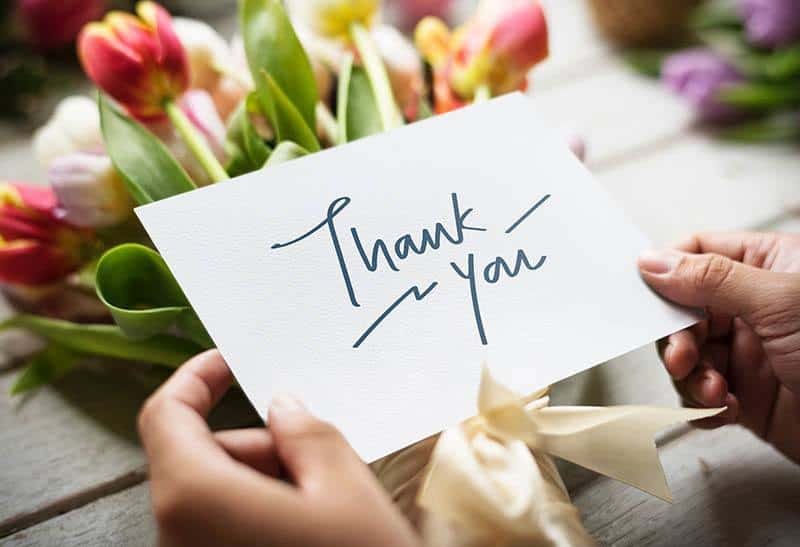 paper with thank you sign