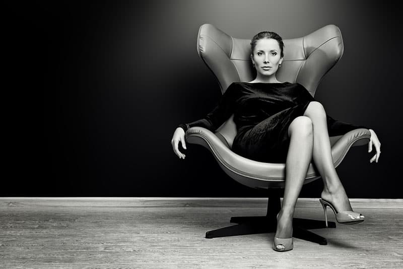 serious confident woman sitting in the chair