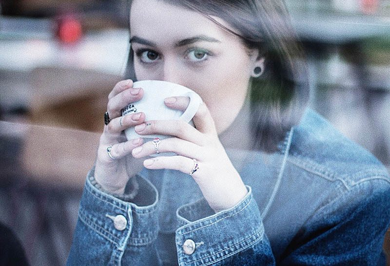 woman drinking coffe and staring