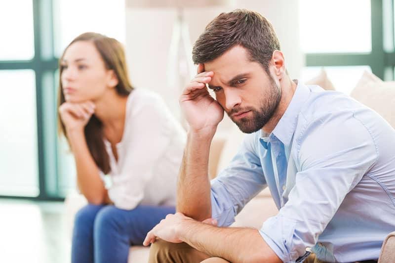 woman ignoring man