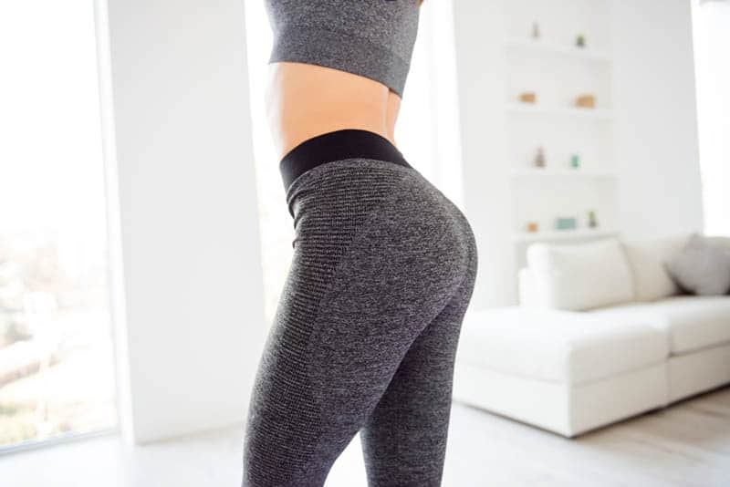 woman in leggings standing at home