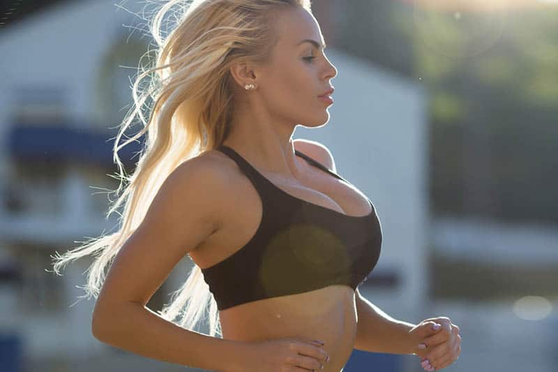 woman running in black sport bra