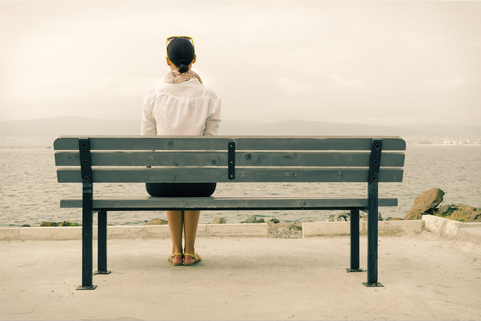 woman sitting alone on the bench