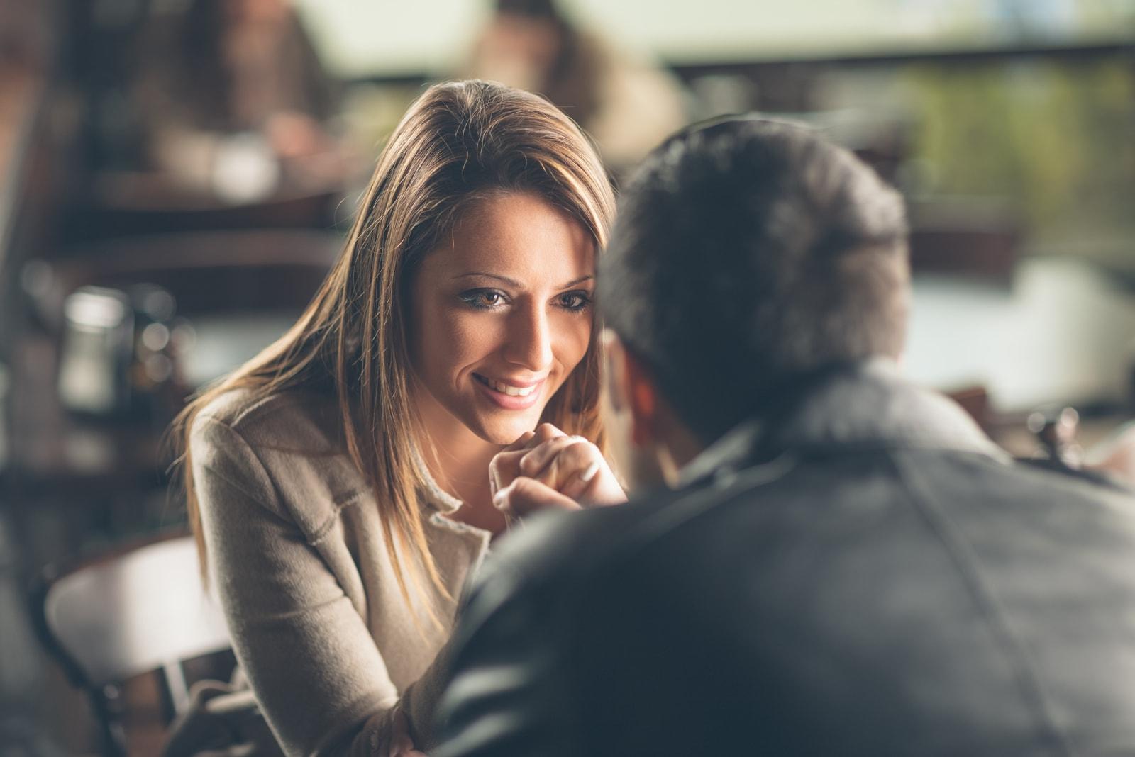 young smiling woman looking at man