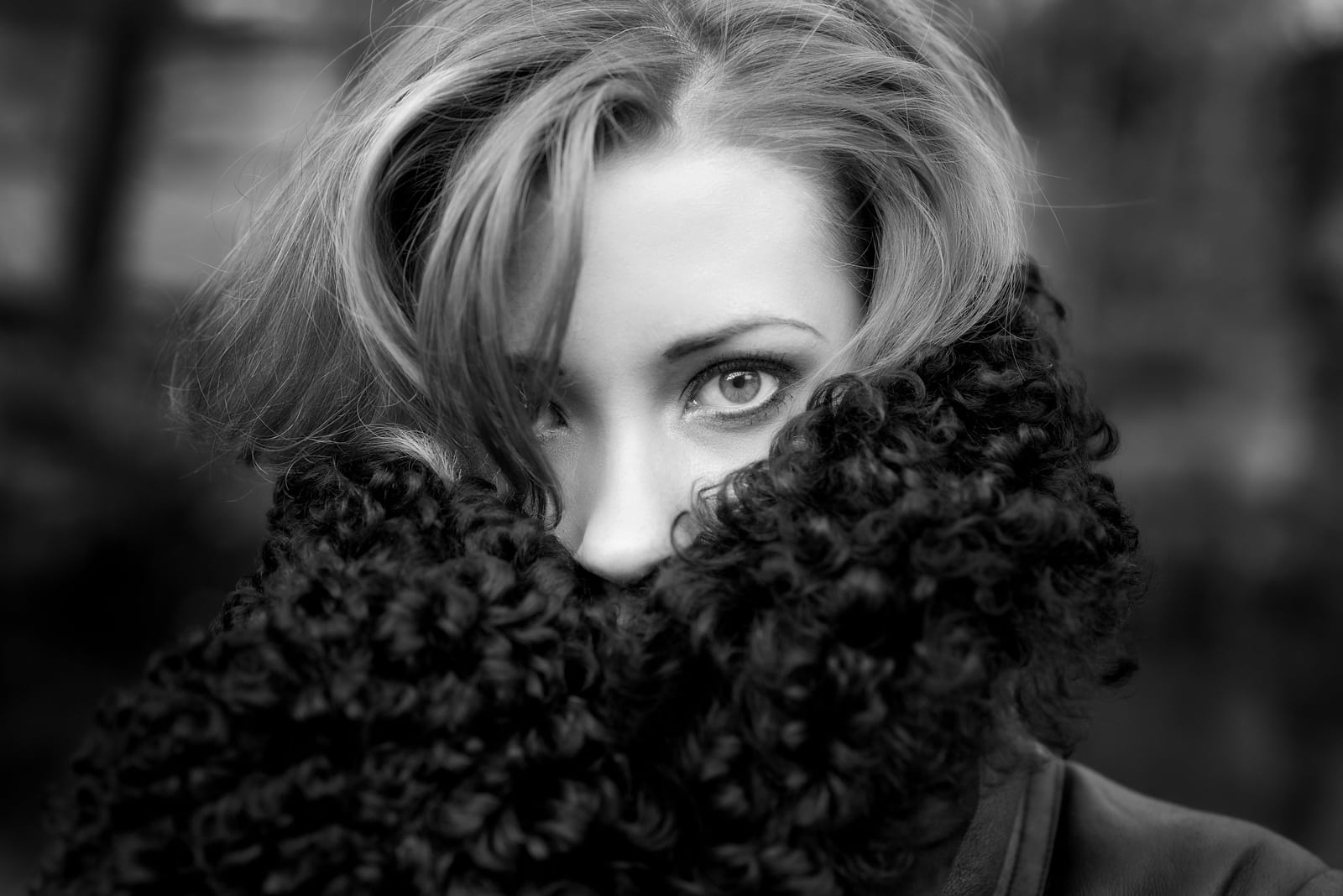 Black and white outdoor portrait of young woman