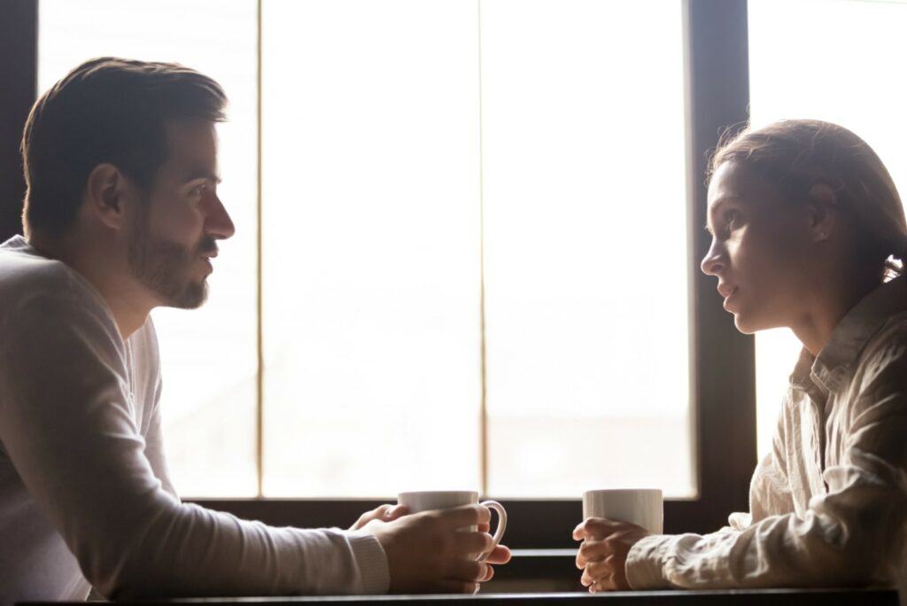 a couple talking in a cafe