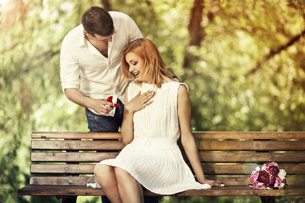 a man proposed to a woman on a bench