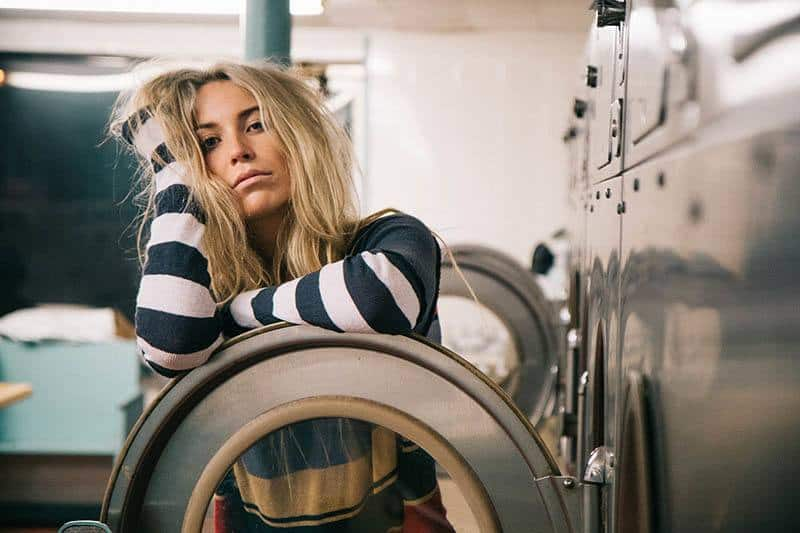 blonde woman in laundry room