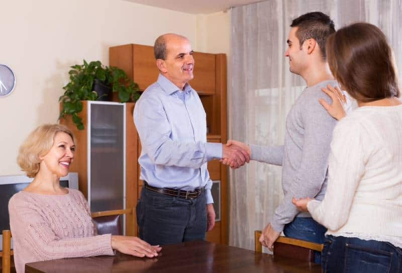 girl introducing her boyfriend to her parents