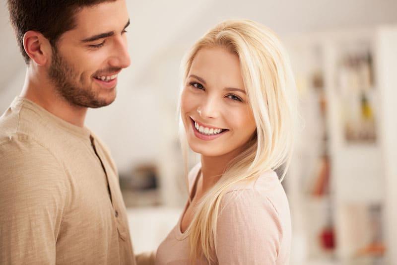 man looking at smiling woman