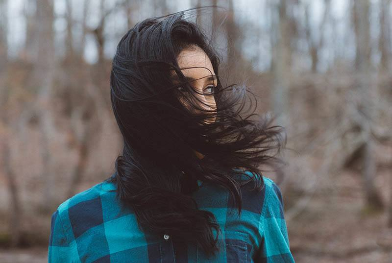wind hair over woman face outside