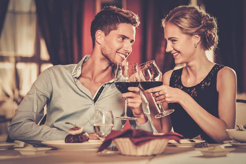 young couple flirting in restaurant