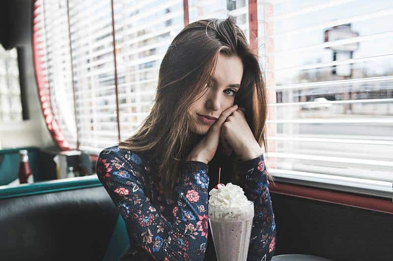 young nice woman sitting in the coffee shop