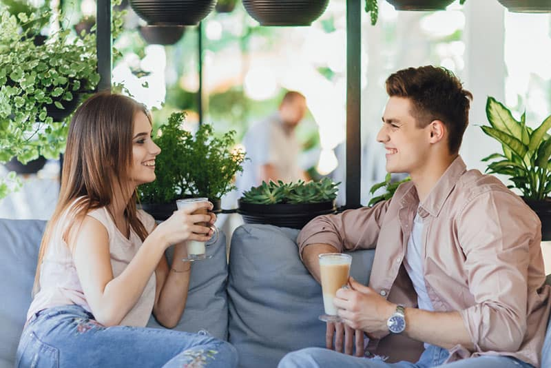 young couple talking at cafe