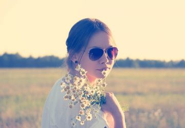 girl wearing sunglasses and flowers outside