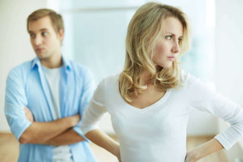 Image of young angry woman arguing with her husband