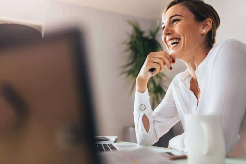 Smiling woman sitting at her desk in the office
