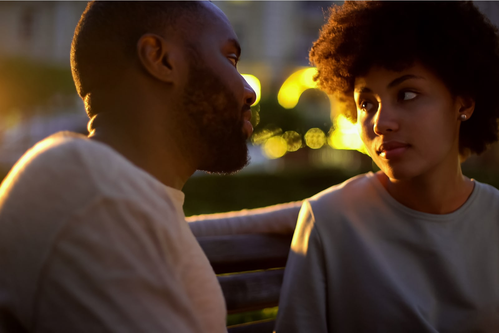 Woman looking at boyfriend with hope