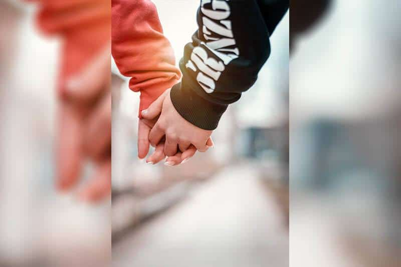 close up photo of couple holding their hands