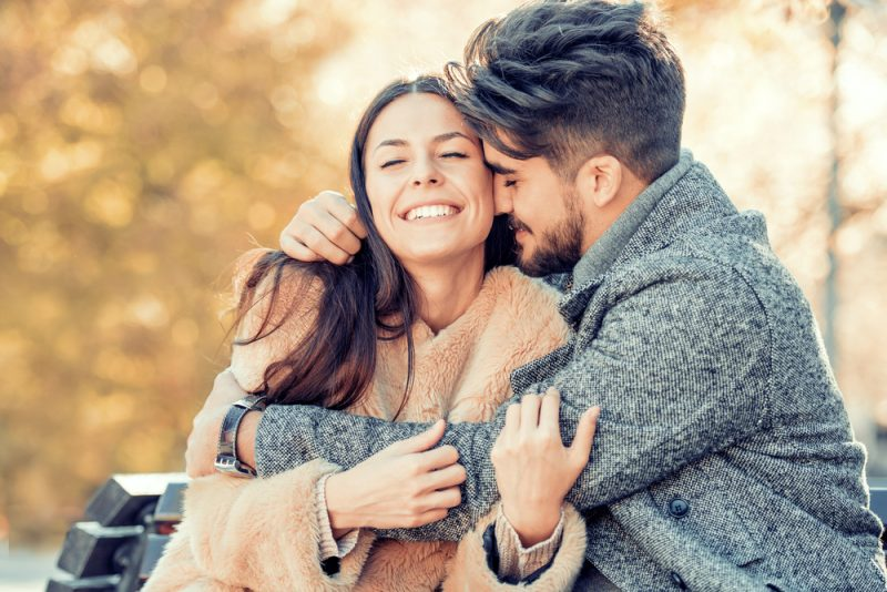 beautiful couple hugging and smiling