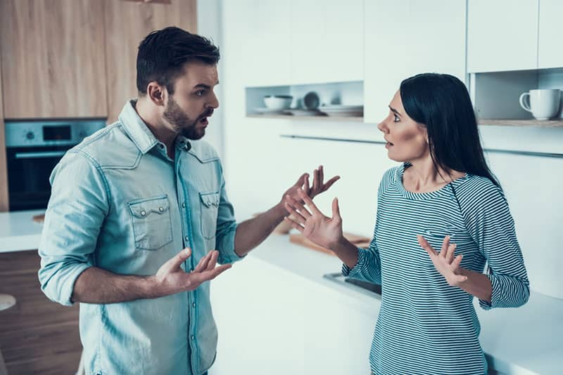 couple arguing in the kitchen