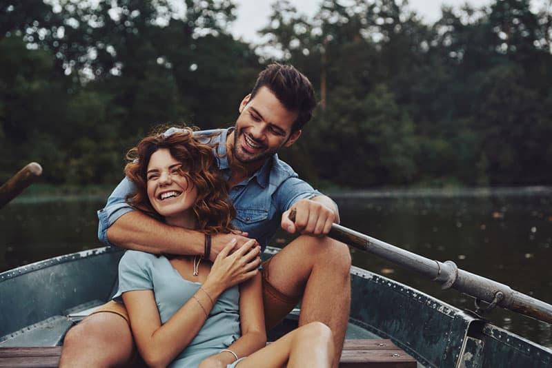 couple enjoying in boat on the lake