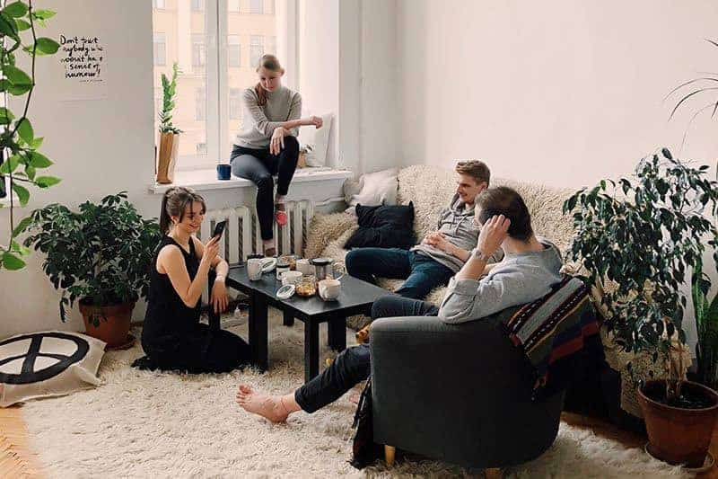 couple hanging with friends in the living room