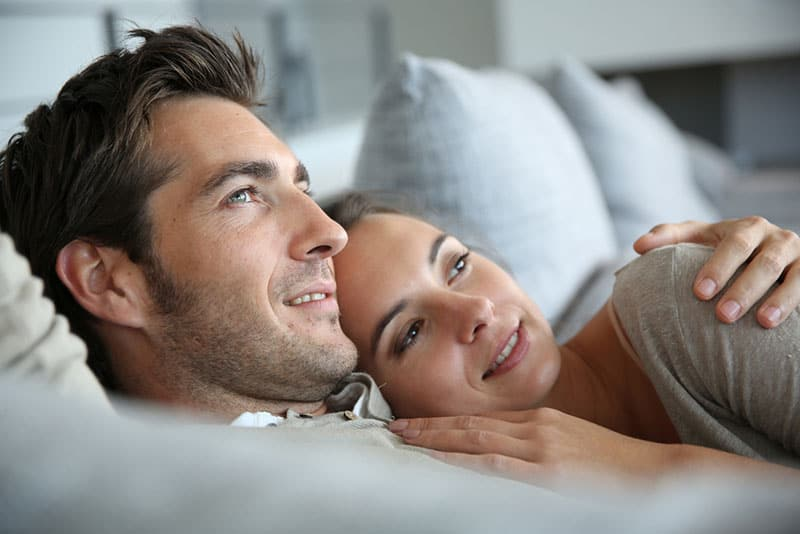 couple laying in hug on the bed