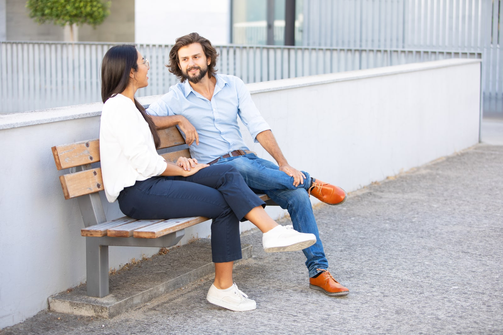 couple sitting on bench talking