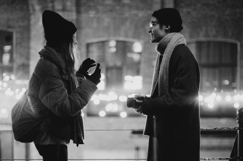 couple talking outside on winter
