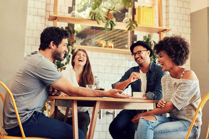 friends having fun in cafe