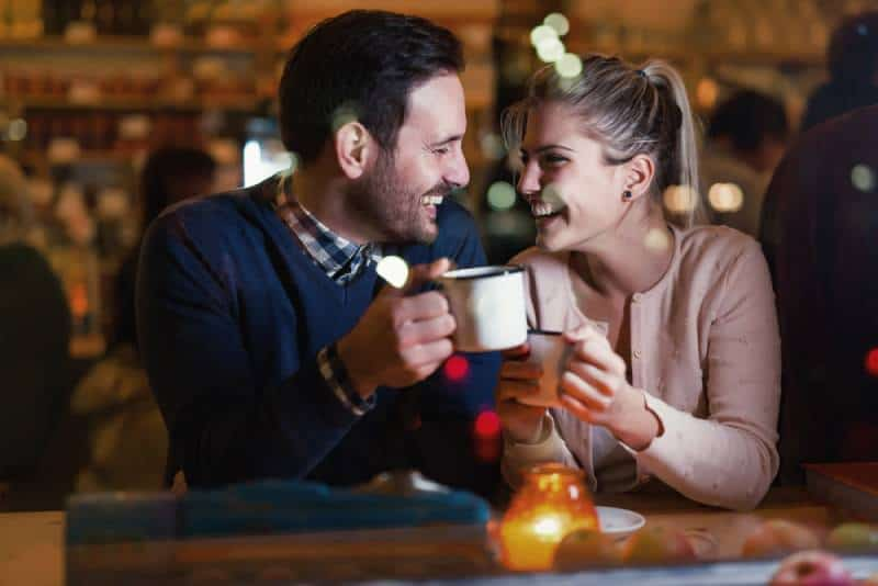 happy couple having a date at bar