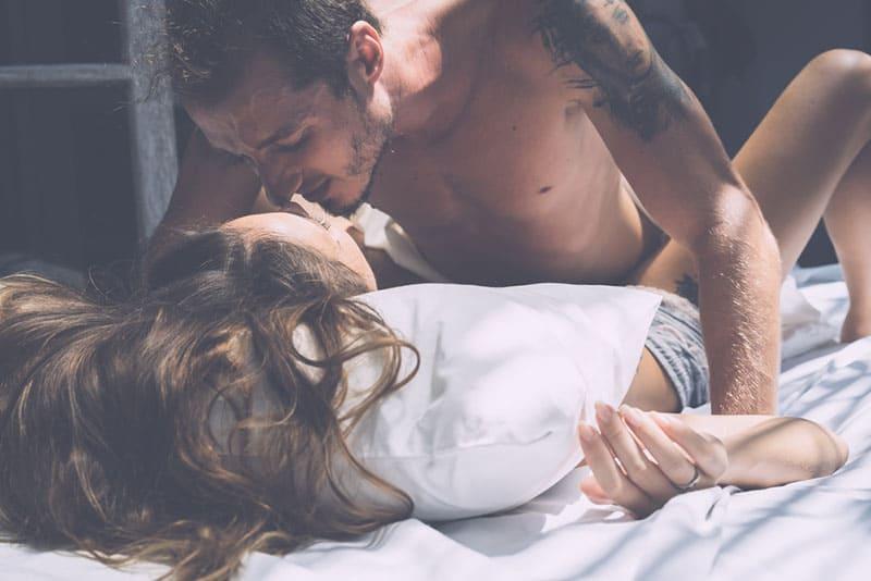 horny man kissing a woman