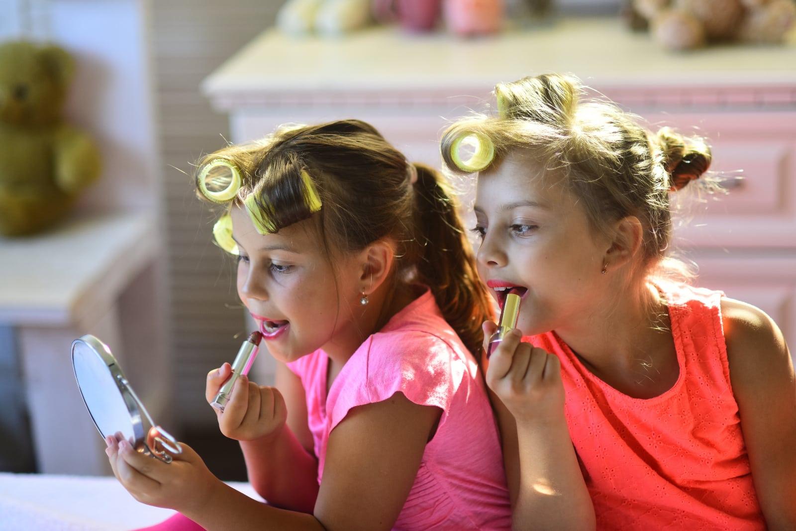 little girls doing makeup