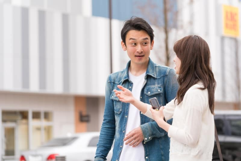 man approaching girl on street